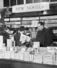 Perusing books at Selfridges 1942